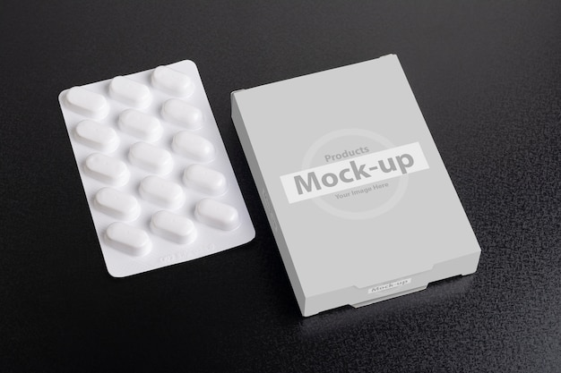 Pillbox mock-up con pagnotta di compresse su oscurità