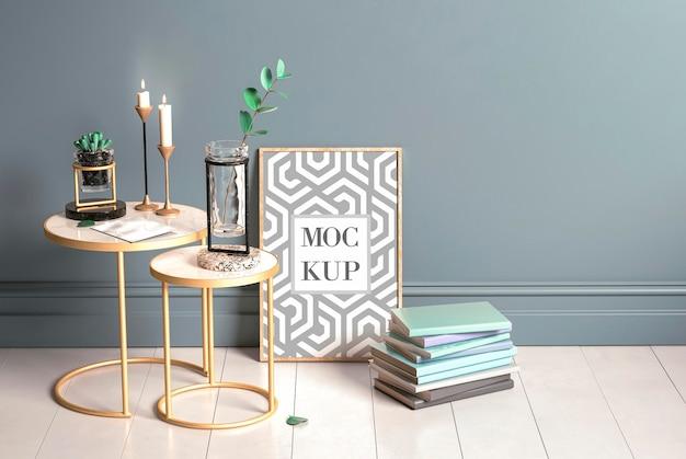 Poster appoggiato sul pavimento con una pila di libri mockup Psd Premium