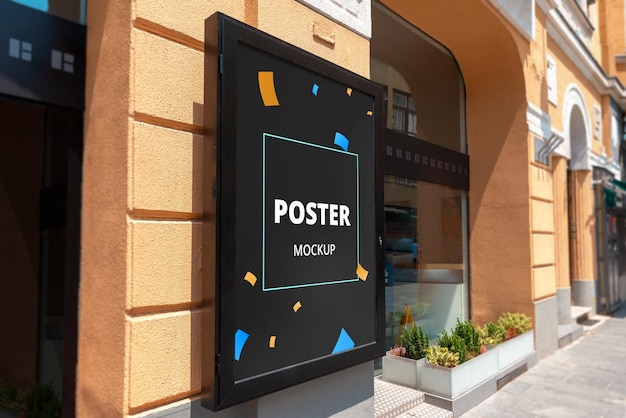 Mockup di poster sul muro di un edificio stradale