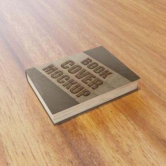 Mockup di copertina del libro premium sul tavolo di legno