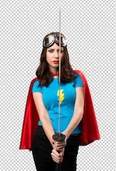 Bella ragazza di supereroi con katana