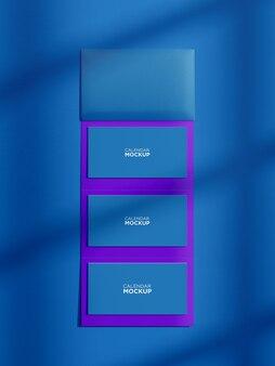 Mockup di calendario appeso realistico con sfondo colorato
