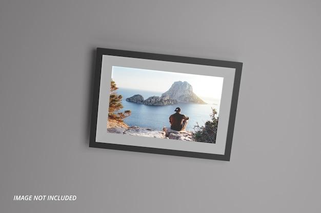 Modello realistico di cornice per foto di paesaggio sul muro psd premium Psd Premium
