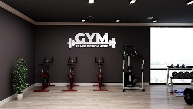Mockup di logo realistico nella moderna sala fitness e palestra