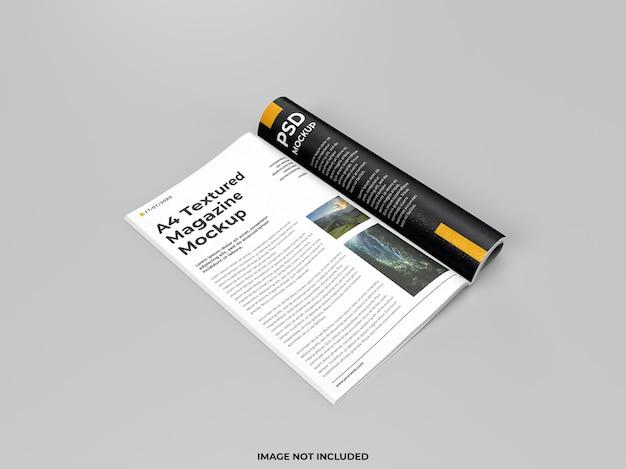 Mockup piegato a rivista aperta realistico