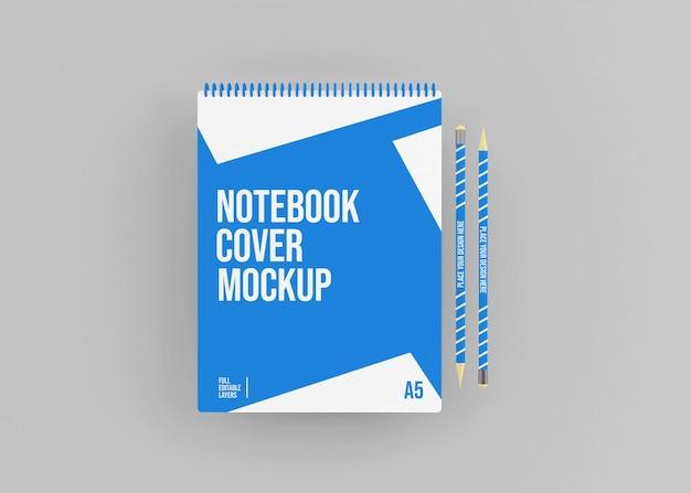 Mockup di quaderno con copertina rigida a spirale realistico con penne