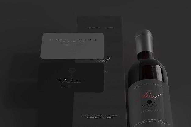 Bottiglia di vino rosso con scatola e biglietto da visita mockup