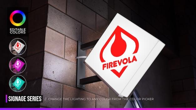 Mockup di logo con segno a forma di rombo sulla facciata o sul negozio con colore di personalizzazione