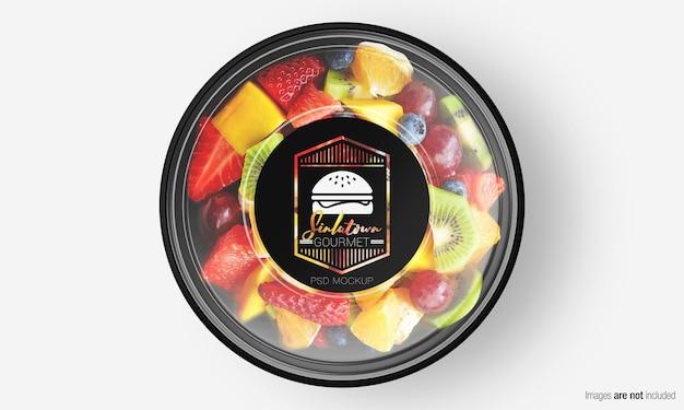 Mockup di scatola di insalata con etichetta su macedonia di frutta