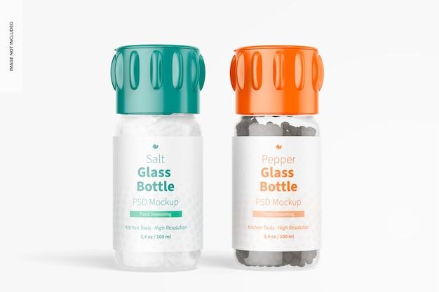 Mockup di bottiglie di vetro sale e pepe, vista frontale