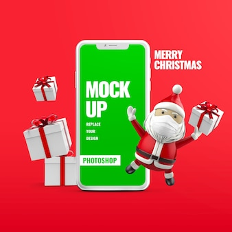 Mockup di telefono pubblicitario di babbo natale con scatola regalo di natale