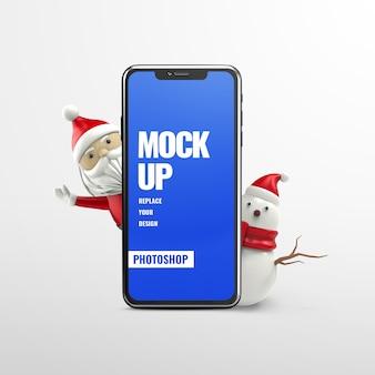 Mockup di telefono pubblicitario di babbo natale e pupazzo di neve