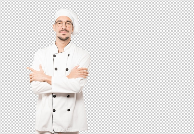 Soddisfatto giovane chef con le braccia incrociate gesto