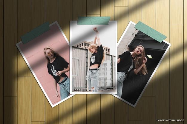 Set di mockup di foto con cornice di carta verticale con sovrapposizione di ombre della finestra e sfondo in legno