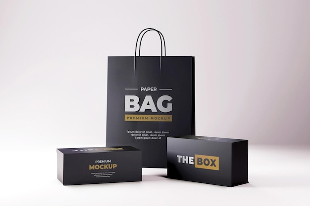 Mockup di scatola di scarpe e borsa della spesa realistica nera