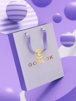 Mockup di shopping bag con logo color oro