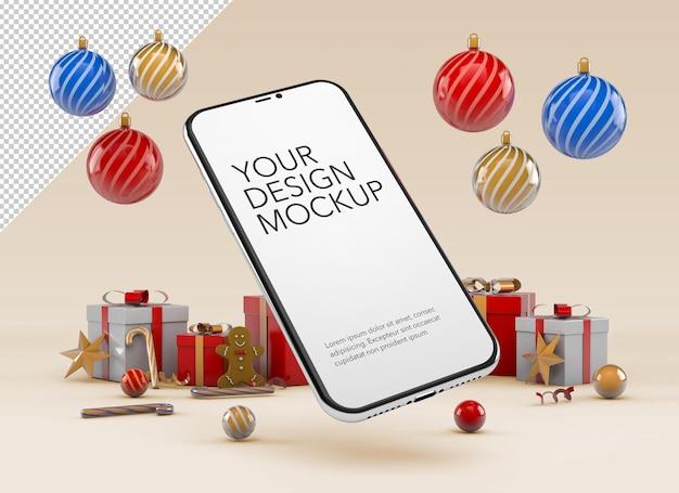 Modello di smartphone con regali e ornamenti natalizi in giro