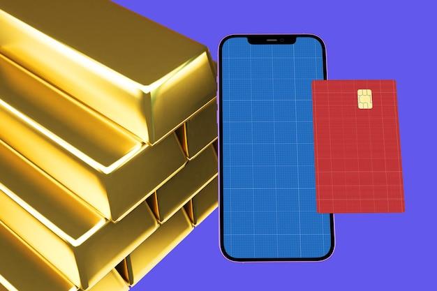 Mockup di smartphone e carta di credito con lingotto d'oro