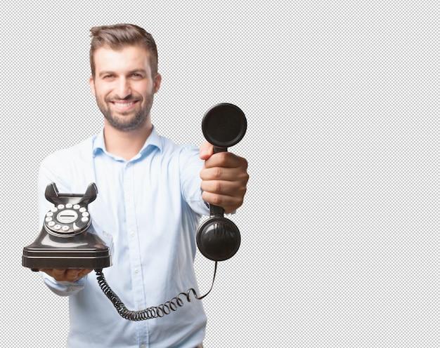 Uomo sorridente con telefono retrò