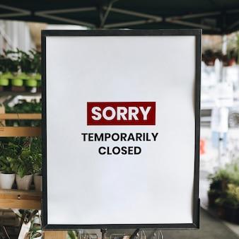 Siamo spiacenti, mockup dell'insegna del negozio temporaneamente chiuso