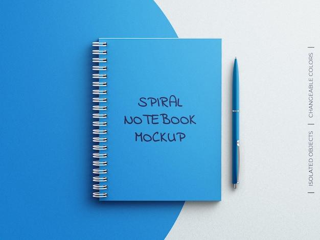 Mockup con copertina rigida del pianificatore del diario del taccuino a spirale con la penna isolata