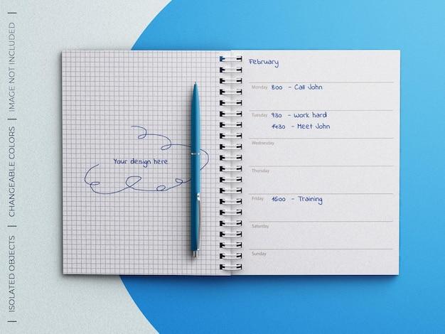Mockup di pagine del pianificatore del diario del taccuino a spirale con la penna isolata