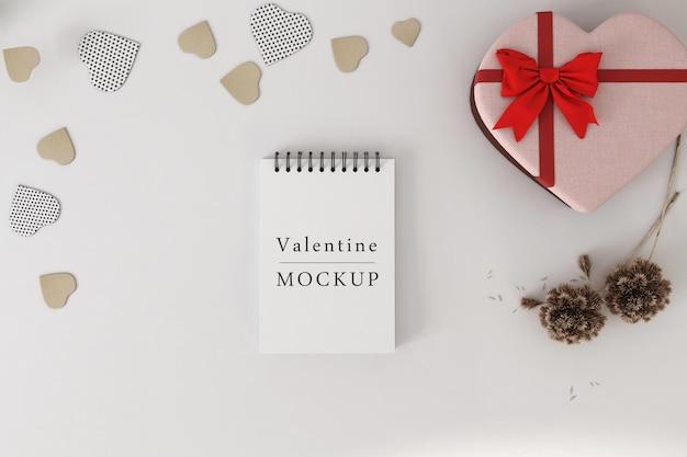 Mockup di quaderno a spirale con il concetto di san valentino