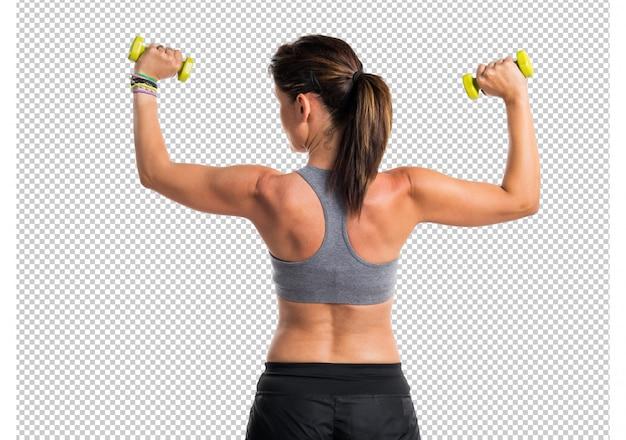 Donna sportiva che fa sollevamento pesi