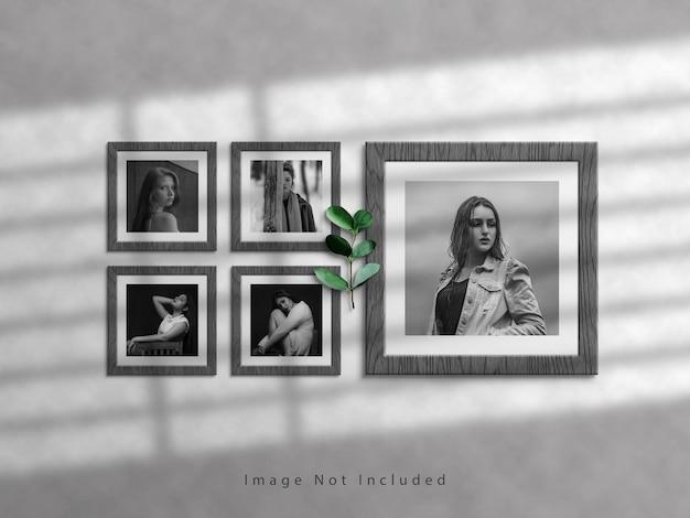 Mockup di cornice per foto quadrata su muro bianco e sovrapposizione di ombre