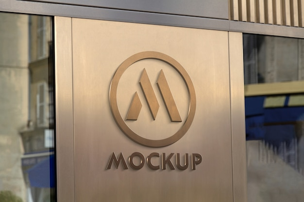 Logo 3d di vetrina su placca di metallo dorato mockup
