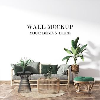 Mockup di parete della stanza della casa estiva con mobili in vimini in rattan