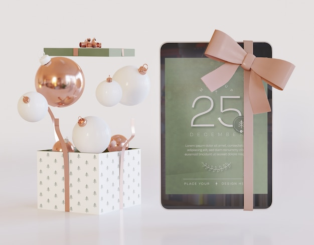 Tablet mockup con decorazioni natalizie