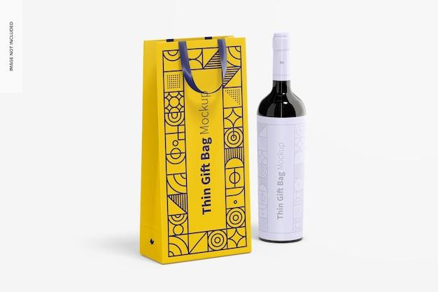 Sacchetto regalo sottile con manico a nastro e mockup di bottiglia di vino