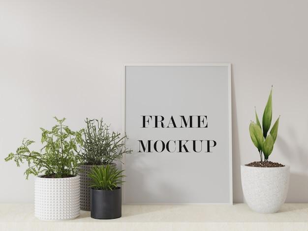 Mockup di cornice bianca sottile circondato da piante