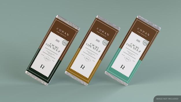 Tavoletta di tre barrette di cioccolato con carta da imballaggio mockup design nel rendering 3d