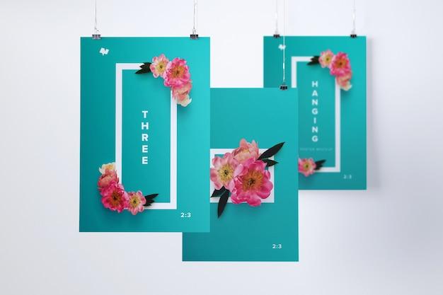 Mockup di tre poster appesi