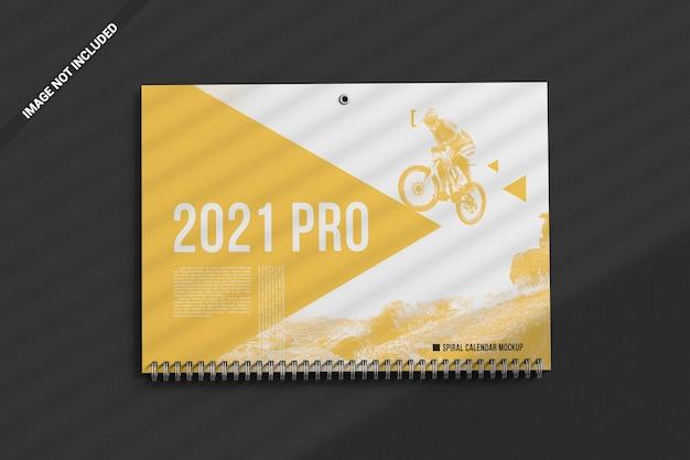 Campo pubblicitario superiore del mockup del calendario a spirale da parete