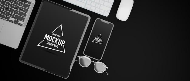 Vista dall'alto del tavolo nero con schermo mockup di dispositivi digitali e rendering 3d occhiali da vista