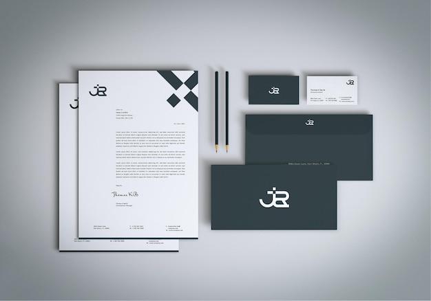 Set di cancelleria minimalista vista dall'alto mockup design