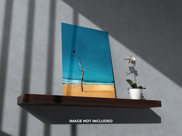Cornice per foto realistica mockup vista dall'alto con fiore