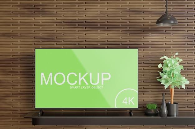 Mockup di visualizzazione tv sul tavolo a muro in legno
