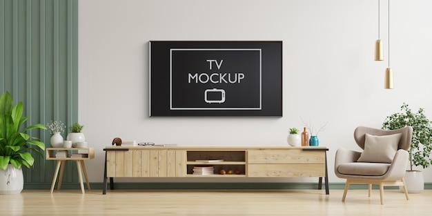 Tv sul muro bianco in soggiorno con poltrona, design minimale, rendering 3d