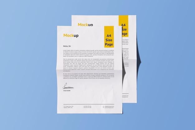 Due a4 realistic fold paper mockup design rendering isolato