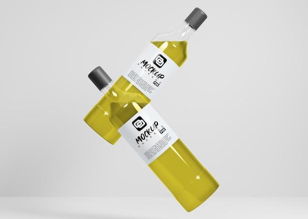 Mockup di due bottiglie che volano Psd Premium