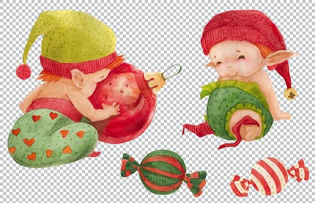 Due bambini elfi di natale e caramelle