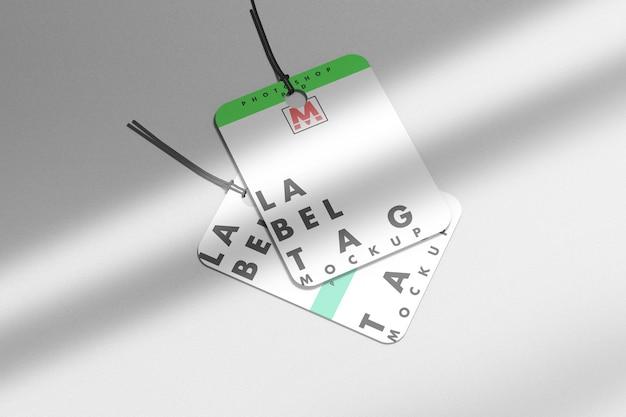 Due mockup di tag etichetta di moda con ombra