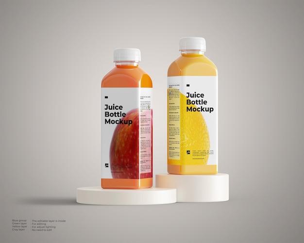 Mockup di due bottiglie di succo sul podio