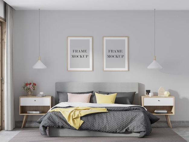 Mockup di due cornici in legno in camera da letto luminosa