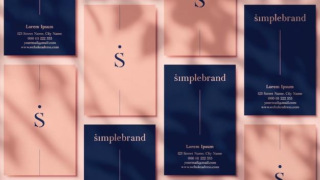 Vari mockup di biglietti da visita verticali per un marchio elegante nel rendering 3d
