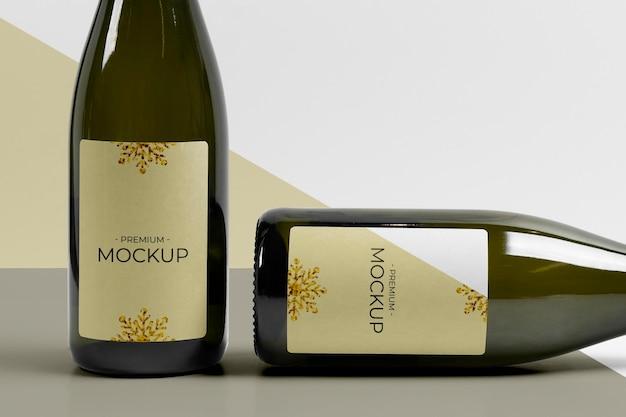 Bottiglie verticali e orizzontali di champagne mock-up